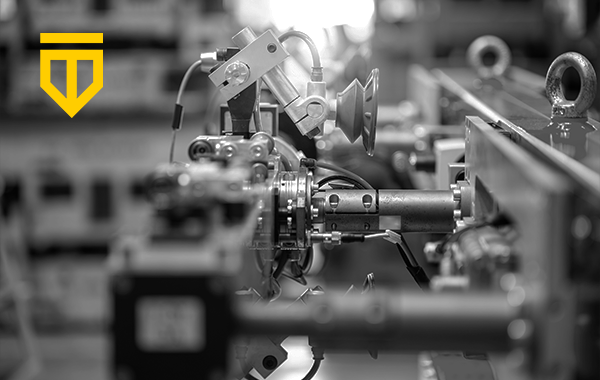 robotic assembly line with Tempered logo